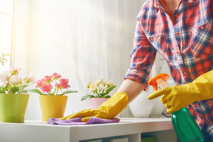Wiping surface down with cleaner