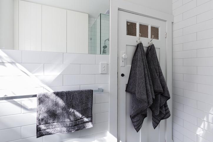 White bathroom with hooks on door
