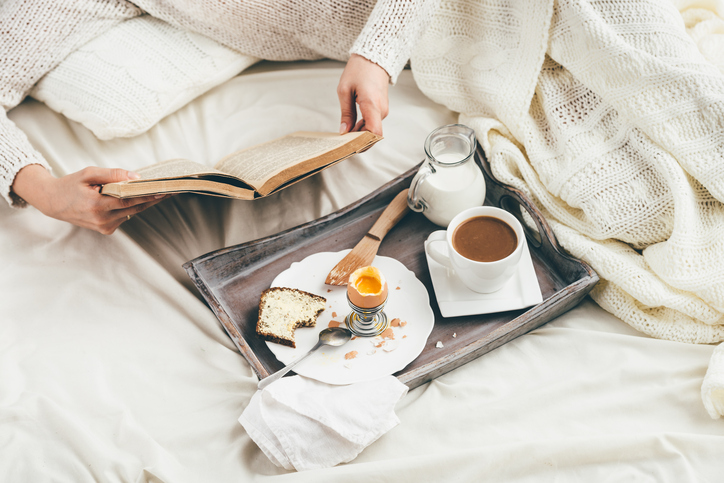 Reading and breakfast in bed summer morning