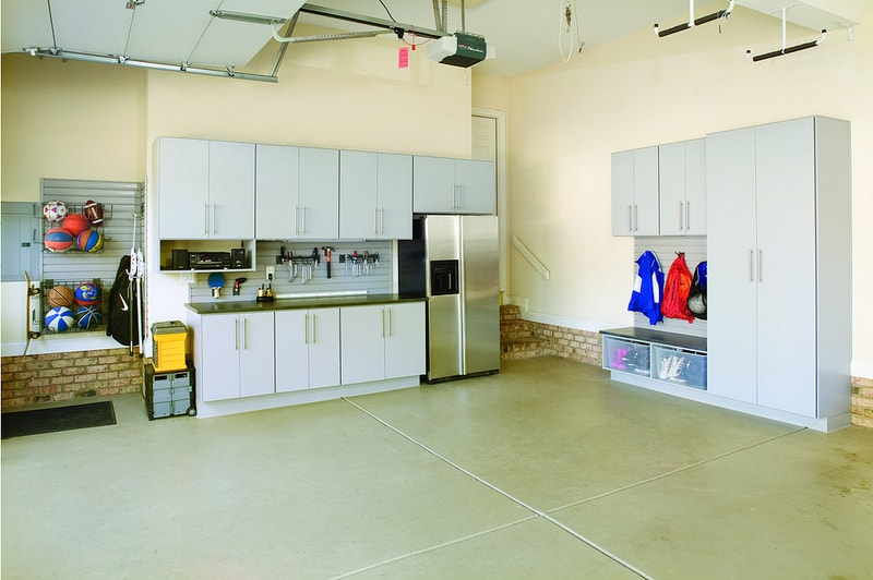 organized garage with custom cabinetry