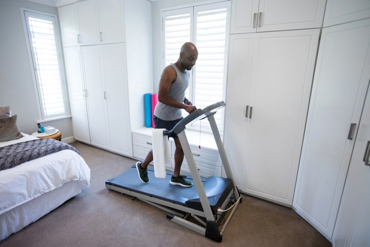 man at home on the treadmill in a bedroom