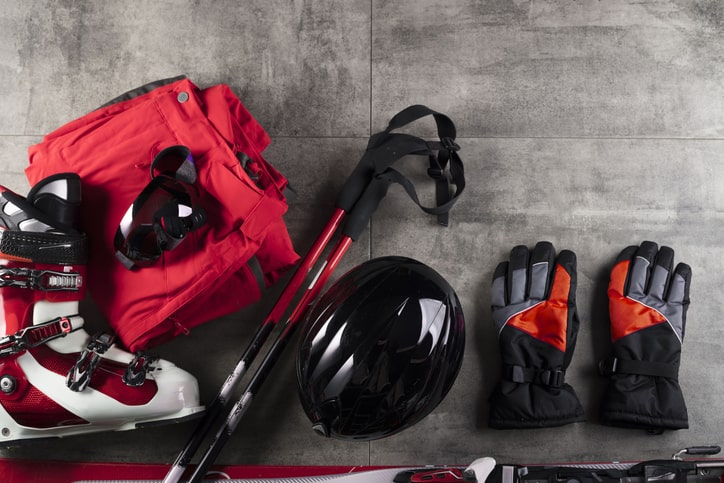 clean winter sports gear on concrete floor