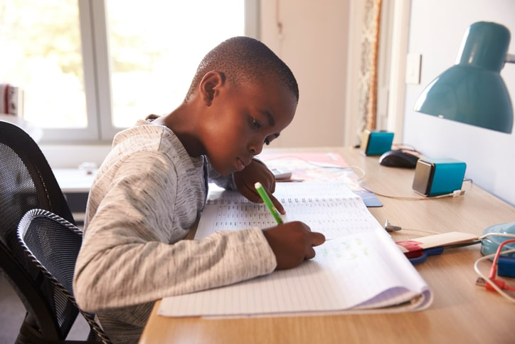 young child studying at organized desk