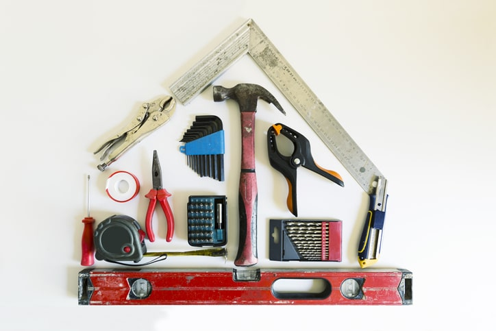 home remodeling tools in shape of a house flatlay