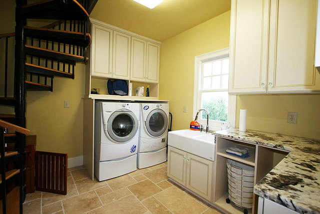 large laundry room with custom cabinets in traditional style