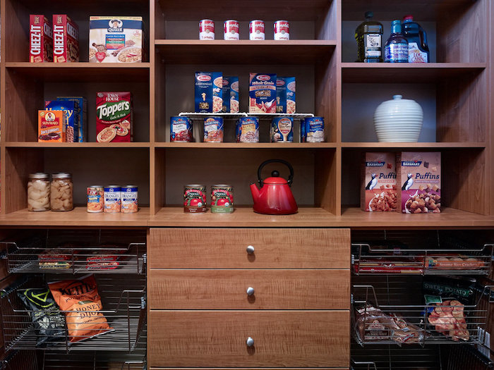 organized custom pantry storage shelving in dark wood