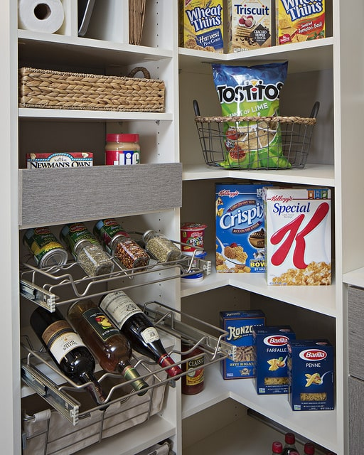 A sleek, modern custom kitchen pantry