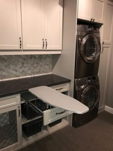 Laundry room with cabinets and foldout ironing board